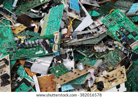 electronic circuits garbage as background from recycle industry  - stock photo