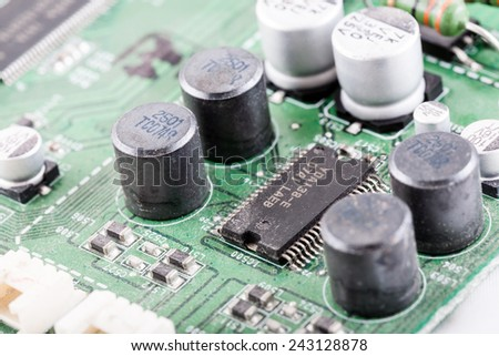Electronic close-up of old computer microchip. - stock photo