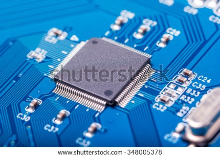 Electronic collection - closeup of computer circuit board with radioelements - stock photo