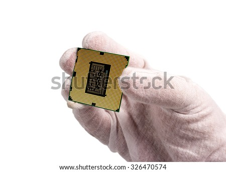 Electronic collection - Computer processor from the bottom side in male hand isolated on white background - stock photo