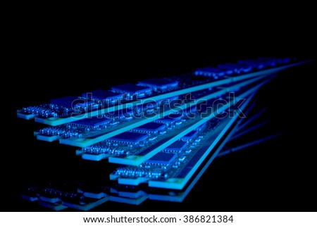Electronic collection - computer random access memory (RAM) modules on the black background toned blue - stock photo