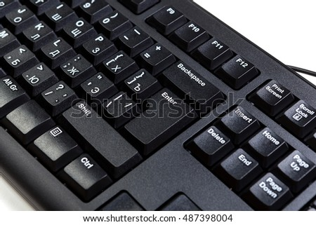 electronic collection - detail black computer keyboard with key enter,  with russian letter, closeup, white background