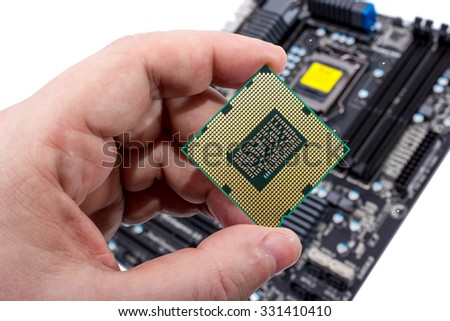 Electronic collection - Installing modern computer processor (CPU) in motherboard - stock photo