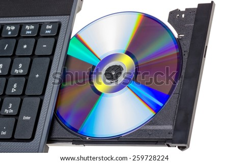 Electronic collection - Laptop with open DVD tray isolated on a white background