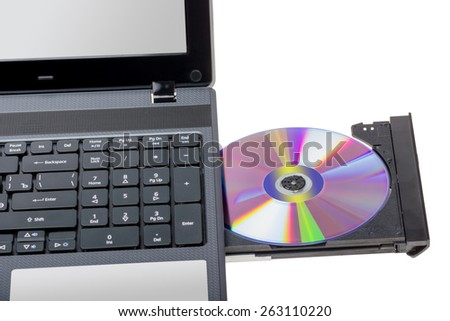 Electronic collection - Laptop with open DVD tray isolated on a white background - stock photo