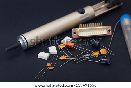 Electronic components in black background - stock photo