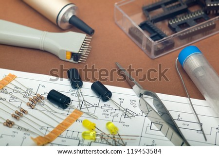 Electronic components in brown background - stock photo