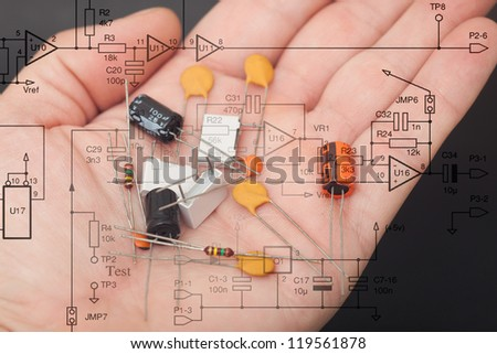 Electronic components in one hand - stock photo
