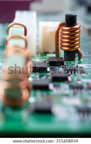 Electronic components of personal computer mainboard. Shallow DOF.