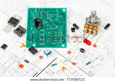 stock photo electronic components over electronic diagram printed wiring transistors integrated circuits 737088523 wiring diagram stock images, royalty free images & vectors  at gsmportal.co