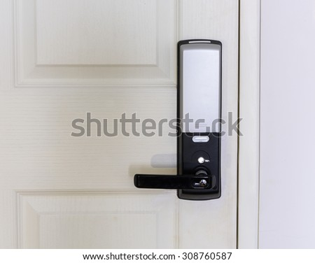 Electronic door lock on white wooden door