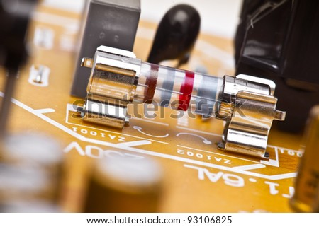 electronic fuse, mounted on a plate of electronic components - stock photo