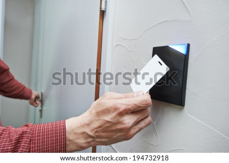 electronic key access system to lock and unlock doors  - stock photo