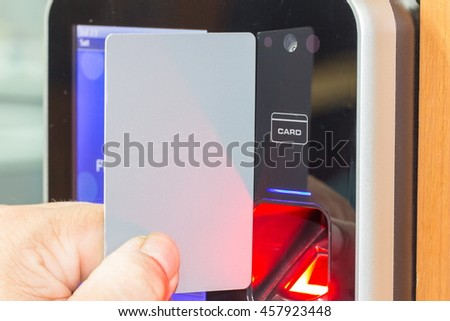 electronic key and finger access control system to lock and unlock doors - stock photo