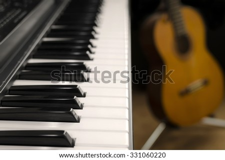 Electronic keyboard & Classic guitar - stock photo