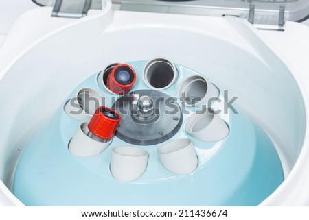 electronic medical blood centrifuge in laboratory - stock photo