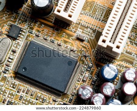 Electronic microcircuit and microchip taken closeup. - stock photo