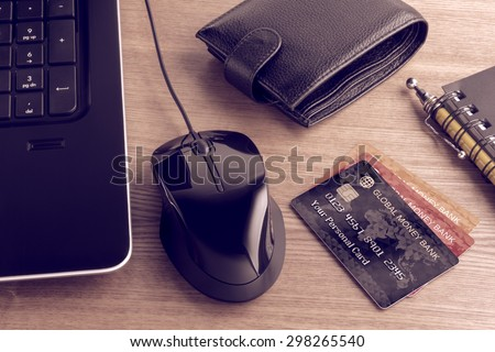 Electronic payments from desktop. Composition on the subject of using modern means of payment for online shopping. Photo and graphic compositing. - stock photo