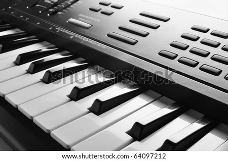 electronic piano keyboard keys closeup in black and white - stock photo