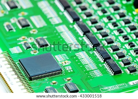 Electronic printed circuit board with many electrical components - stock photo