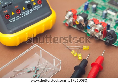 Electronic repair in brown background - stock photo