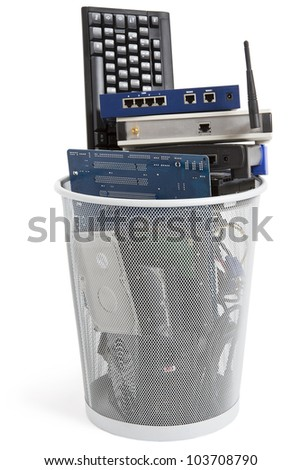 electronic scrap in trash can. keyboard, power supply, cables, logicboard, hard drive - isolated on white background - stock photo