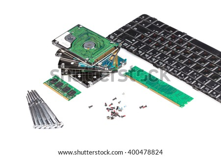 electronic scrap keyboard, power supply, cables, logicboard, hard drive - isolated on white background