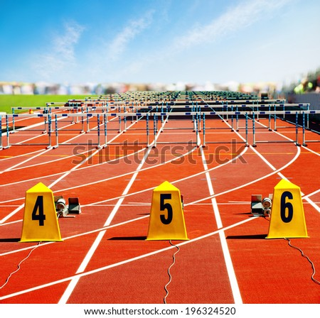 Electronic starting line on stadium running track  - stock photo