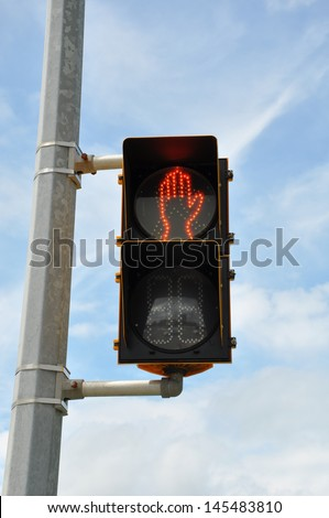 Electronic stop sign - Do not cross the street - stock photo