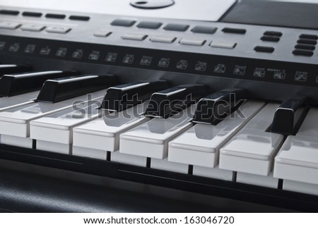 Electronic synthesizer keyboard - stock photo