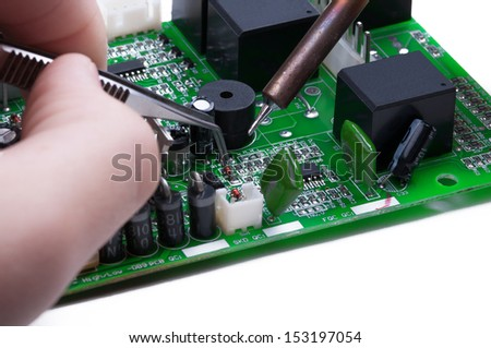Electronic technician operates with circuit board. Close-up.  - stock photo