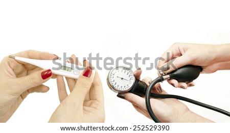 Electronic thermometer and blood pressure in women's hands on a white background