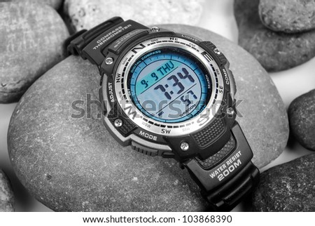 Electronic waterproof watch on stone - stock photo