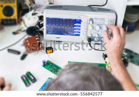 Electronic working place with soldering iron and circuit board