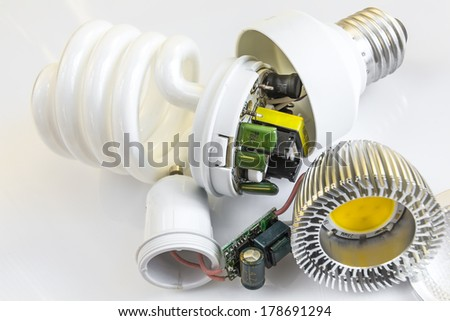 electronics in the GU10 LED bulbs and compact fluorescent lamps E27,  CFL - stock photo
