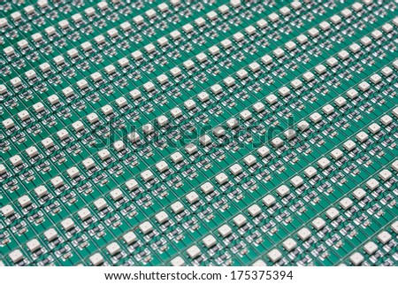 Electronics - LED chips on the green PCB - stock photo