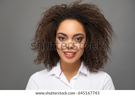 Elegance and beautiful African American young model girl studio portrait on grey background.