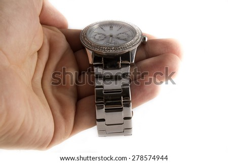 Elegance and beautiful wristwatch on hand isolated on white background - stock photo