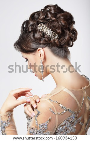 Elegance and Chic. Beautiful Brunette with Classy Hairstyle. Luxury - stock photo