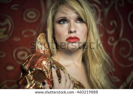 Elegance, blonde dressed in red armor gold on red art nouveau flourishes