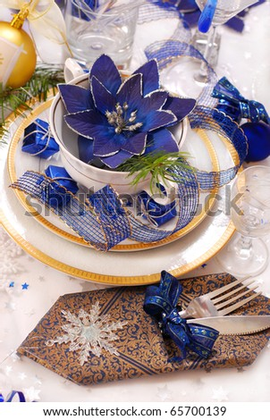 elegance christmas table decoration in white,blue and golden colors - stock photo