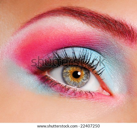 Elegance close-up of woman's eye with multicolored eyeliner and eyeshadow - stock photo