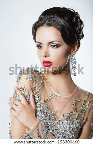 Elegance. Luxurious Good Looking Woman in Dress with Sequins and Jewels - stock photo