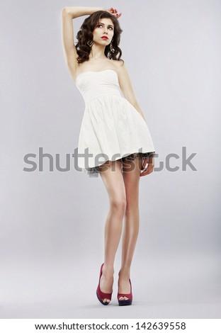 Elegance. Stylish Brunette in Light Sundress posing. Fashion Style - stock photo