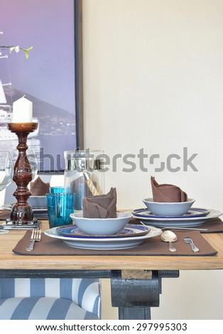 elegance table set on wooden dinning table at home