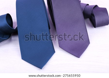 Elegance ties on wooden table, closeup - stock photo