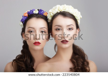 Elegance. Two Women with Wreaths of Flowers. Fantasy  - stock photo