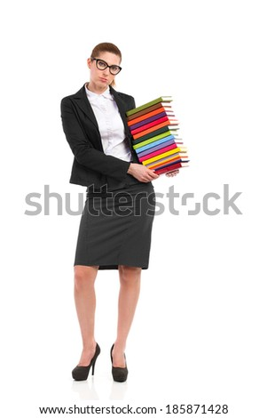 Elegance woman carrying heavy stack of books. Full length studio shot isolated on white. - stock photo