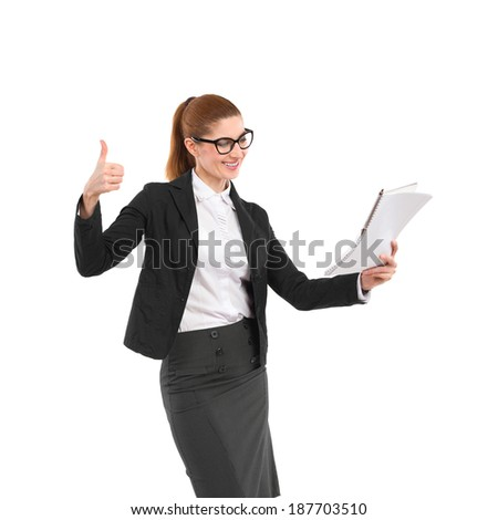 Elegance woman in black suit looking at notebook and showing thumb up. Three quarter length studio shot isolated on white. - stock photo