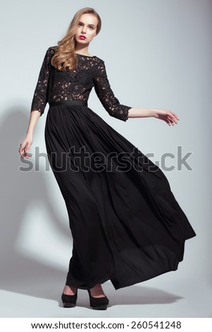 Elegance. Young Fashion Model in Black Dress - stock photo